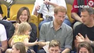 Cute little girl eats prince harry popcorn