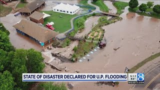 Flooding kills 1 in WI, sparks MI disaster declaration