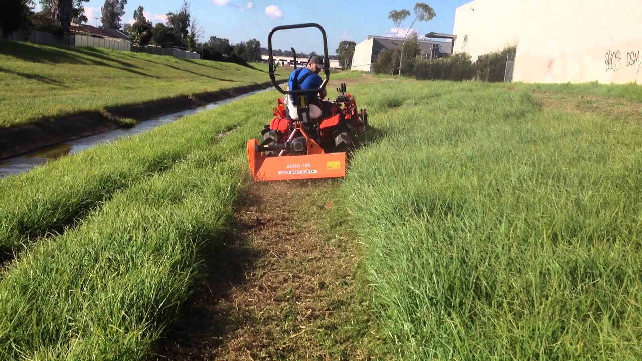 Kubota B7100 Tractor With Flail Mower Working In Long