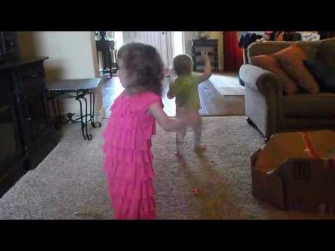 Kate and Elle hula dance with Barney