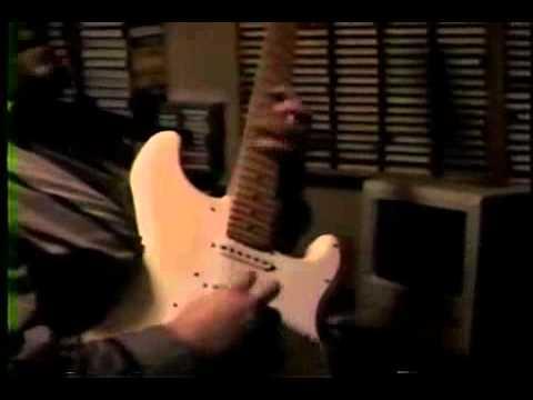 Shawn Lane shredding on a White Stratocaster ( 1991)