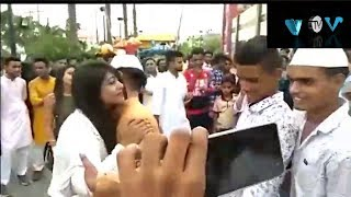 Girl hugs long line of men in Eid