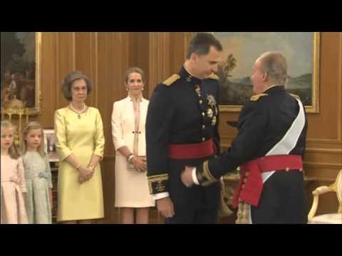 Spain's new king Felipe VI receives the royal sash
