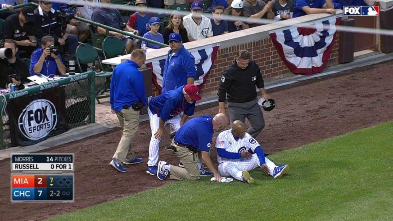 MIA@CHC: Third-base coach Jones gets struck by liner