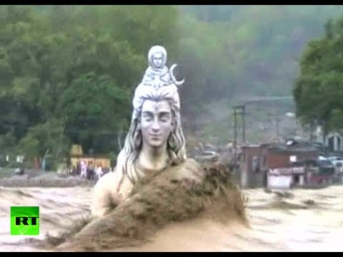 Video: Ground crumbles underfoot as apocalyptic floods sweep India