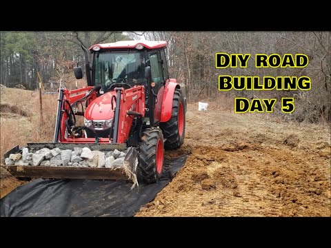 Building a new road DAY 5 RIP RAP Ditch & Branson Tractor!