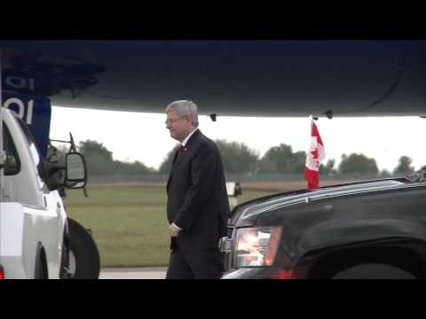 Prime Minister Stephen Harper waves goodbye as he departs for the G-20