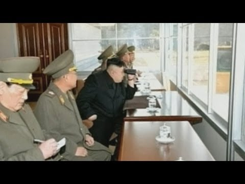 North Korea: Kim Jong-un launches missile into sea and watches shooting contest