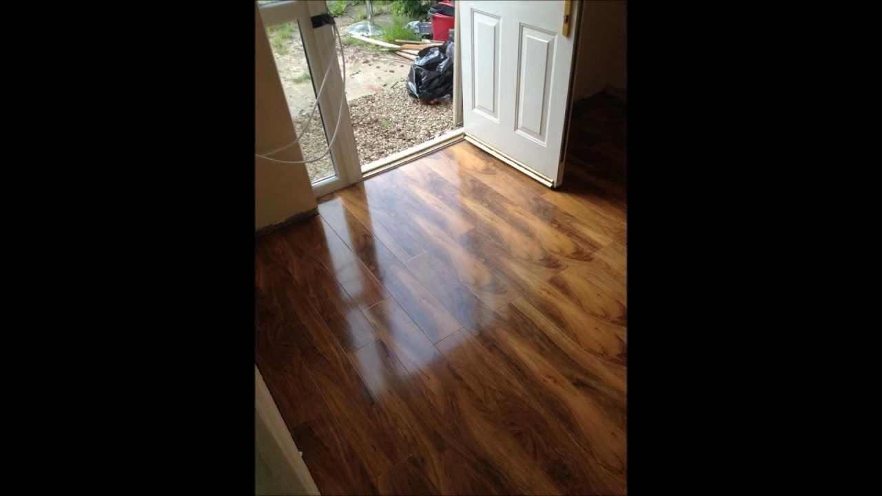 Laminate flooring by perfection flooring beveloc walnut for Hardwood floors not shiny