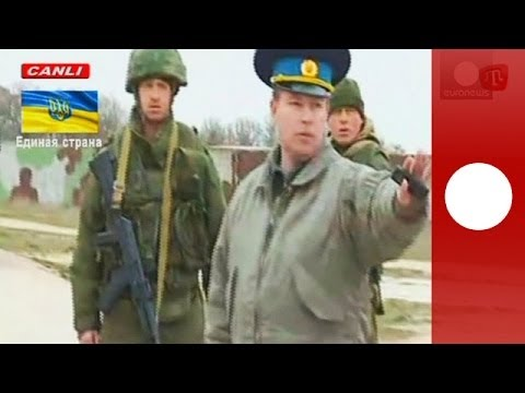 Russian forces fired warning shots in to the air as ranks of unarmed Ukrainian soldiers marched towards them at Belbek air base in Crimea on Tuesday (March 4...