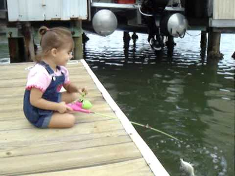 2 year old reels in fish then releases