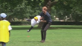Playful Prince Harry joins in children's handball game