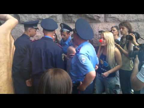 Ukrainian FEMEN feminist activist draged away by police in Kyiv
