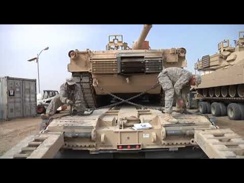 M1 Abrams Tanks being loaded into trucks for shipment out of Base ADDER, IRAQ