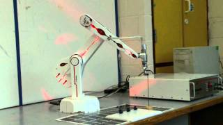 ST Robotics R12-six small low cost 6-axis benchtop robot arm.