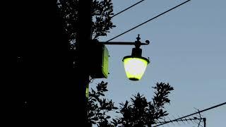 Old Street Lamp in Village Lighting Up