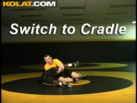 Switch Defense to Top Leg Cradle KOLAT.COM Wrestling Techniques Moves Instruction Image 1