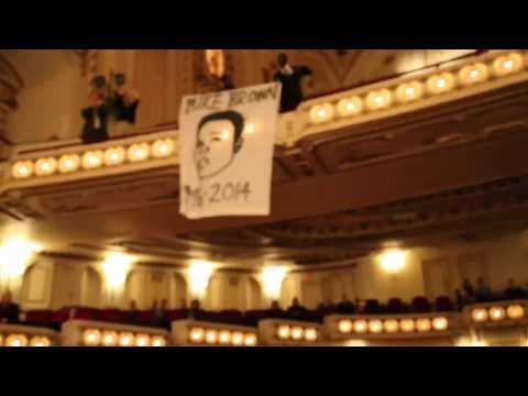 Demonstrators interrupt STL symphony singing a 'Requiem for Mike Brown'
