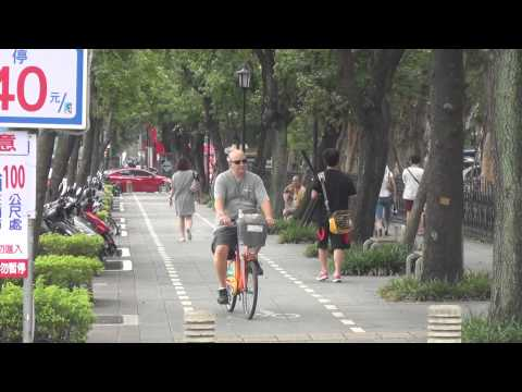Dad on a Free Rental Bike in Taipei, Taiwan