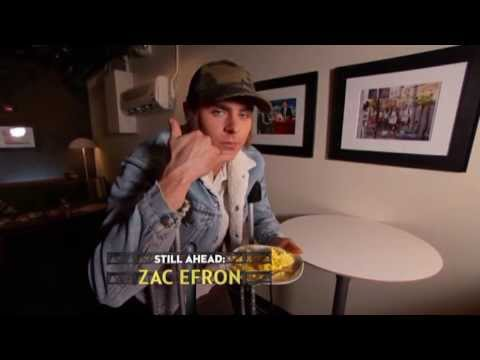 Zac Efron eats and winks