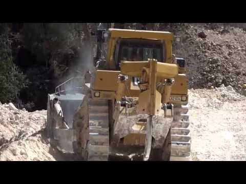 Mountain road-building with Caterpillar D10 and 345s with rock hammer