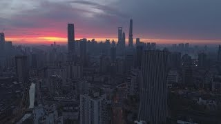 Panoramic Aerial View of Shanghai Skyline at Twilight. China. Drone Is Flying Upward | Stock