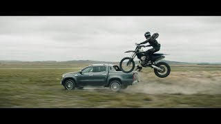 Watch the powerful X-Class V6 let the paparazzi eat dust.