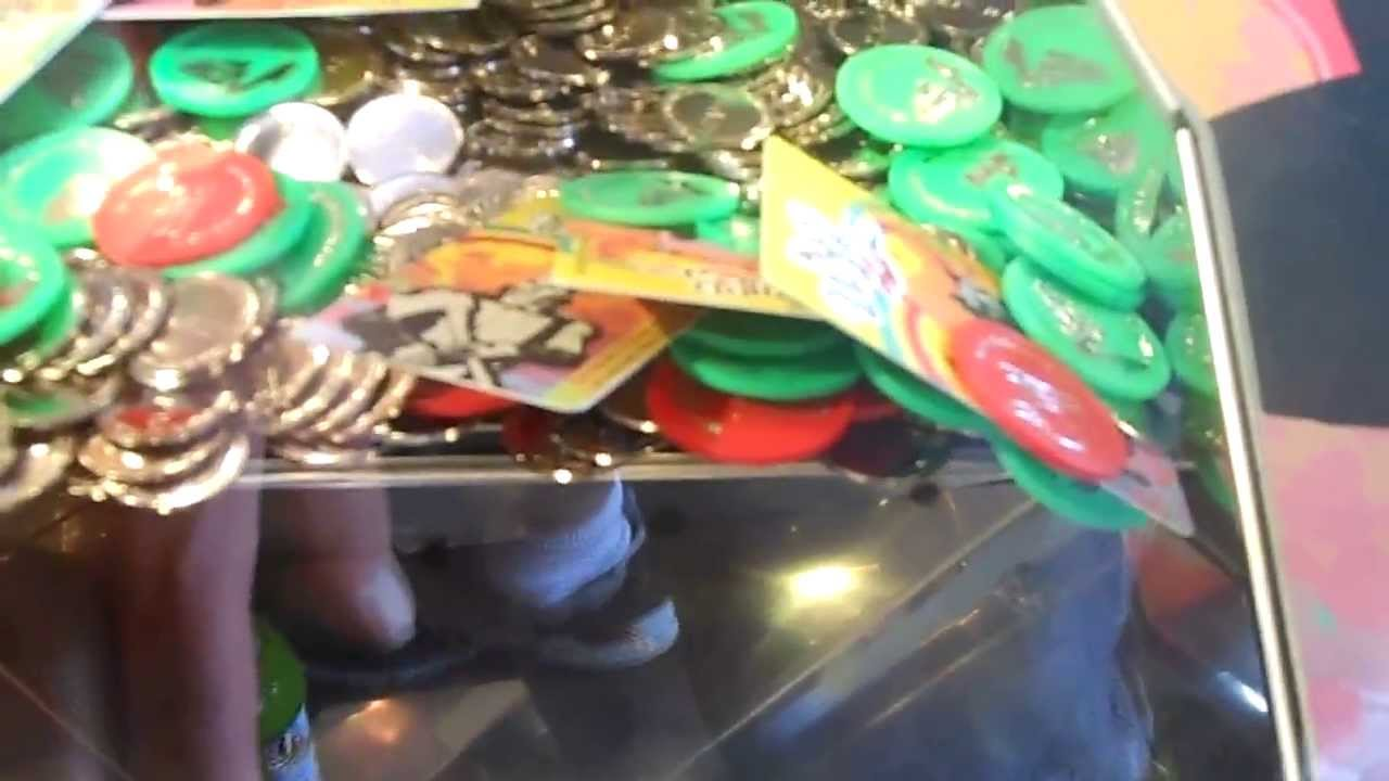 how to play wizard of oz coin pusher