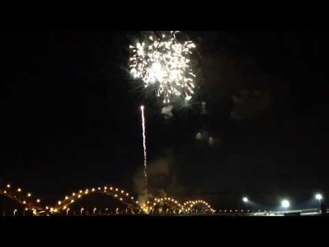 The fireworks spectacular was fired from the Centennial Bridge between Rock Island, IL and Davenport, IA over the Mississippi River due to flooding. The video was taken from Modern Woodmen...