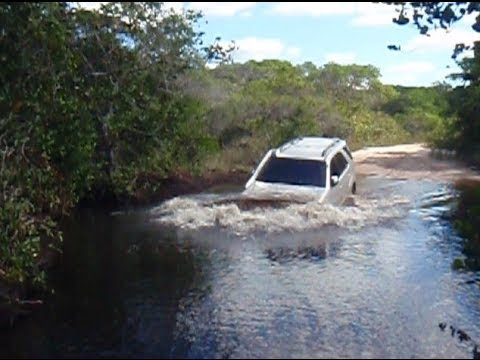Toyota Fortuner (Hilux 4Runner Prado SW4 with snokel) crossing a small river