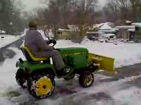 John Deere 318 Pushing Snow