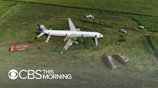 Russian plane crash lands in corn field after hitting a flock of birds