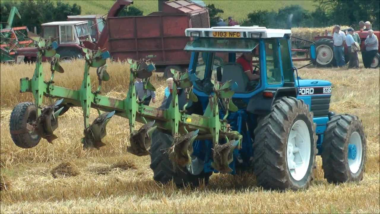 Big Ford tractor ploughing - YouTube