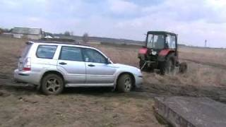 In winter I help MTZ and now MTZ help my. With Forester in mud