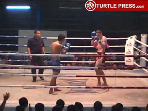 Muay Thai Fight - TKO by Leg Kicks Image 1