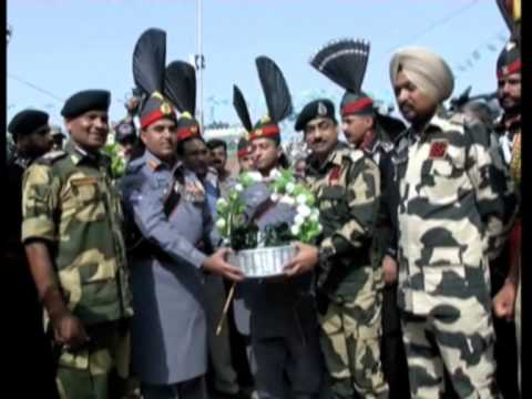 India, Pakistan border guards exchange sweets on Independence Day