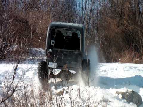 Jeep TJ on 39s playing in the snow