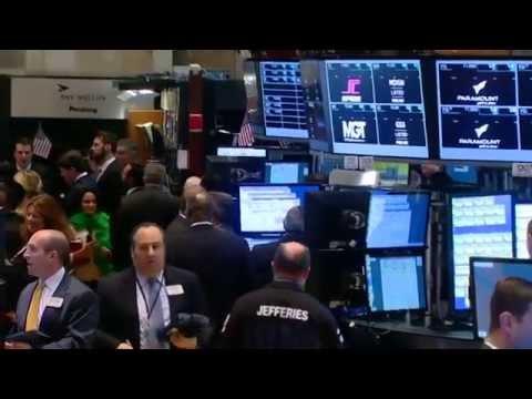 Amex profit beat; Schlumberger job cuts