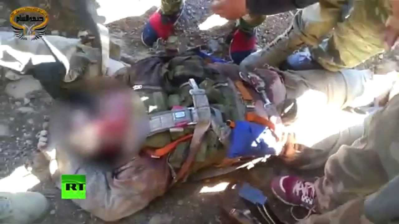 GRAPHIC: New video of immobile Russian Su-24 pilot surrounded by armed rebels emerges