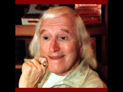 Jimmy Savile sings the Jim'll Fist It theme tune