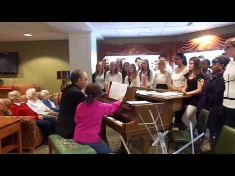 The Charles Finney High School Choir Sings Christmas Bell Roundelay