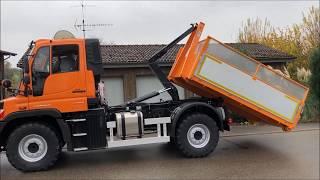 Unimog U218 mit HEN-AG Abrollcontainersystem und bema Kehrbesen