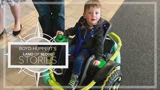 MN high school robotics students build power wheelchair for 2-year-old