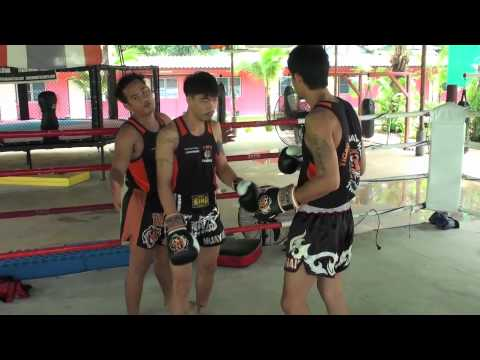Tiger Muay Thai Techniques: Side step with lead hook followed by leg kick Image 1