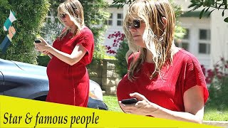 Kirsten Dunst drapes her baby bump in loose-fitting red dress