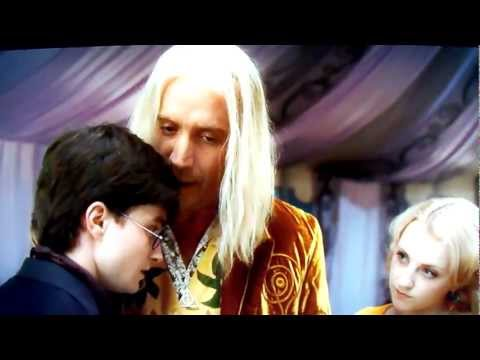 RHYS IFANS AS XENOPHILIUS LOVEGOOD AND HIS DAUGHTER LUNA IN HARRY POTTER AND THE DEATHLY HALLOWS