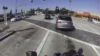 Motorcyclist Startles Driver For Running Red Light
