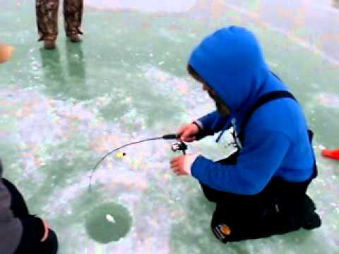 Milwaukee harbor ice fishing. Milwaukee harbor brown trout steelhead. Wisconsin fishing guide Kueng