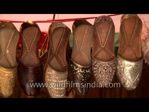 Hornbill Festival stall showcasing Indian mojaris and shoes