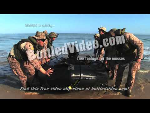 Marine Corp Special Operations Force Arrive on Shore via Zodiac Raft